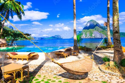 Fototapeta Tropical holidays - exotic islands oF El Nido. Palawan, Philippines. relaxing scenery with hammock obraz