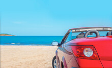 Red Car On The Beach. Cars On The Beach. Vacation And Freedom Concept.