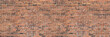 Dark brown old bricks wall panorama