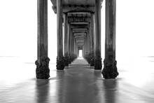 La Jolla Beach, California, Long Exposure Under The Pier, Black And White Image.