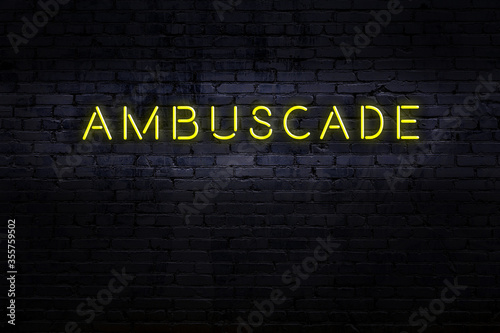 Neon sign. Word ambuscade against brick wall. Night view Wallpaper Mural