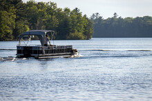 Pontoon Boat With Canopy On Lake