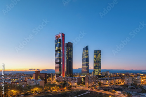 Valokuvatapetti Madrid Spain, night city skyline at financial district center with four towers