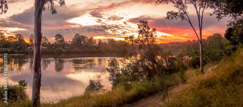 Obraz Panoramic River Sunset with Reflections - fototapety do salonu