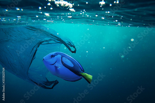 Cuadros en Lienzo A fish with a plastic bad. Pollution in oceans concept.