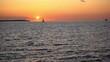 Yacht boat sailing on horizon. Nautical vessel sailing against golden sunset in Sweden, Oresund strait