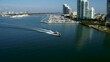 boat going across miami bay by aerial drone