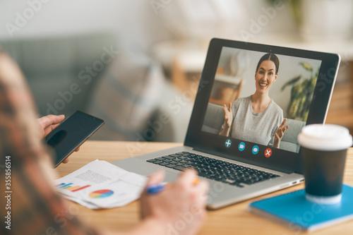 Fototapeta Man is using laptop pc for remote conversation obraz