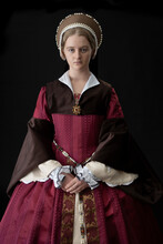 A Young Woman In A Red Tudor D...