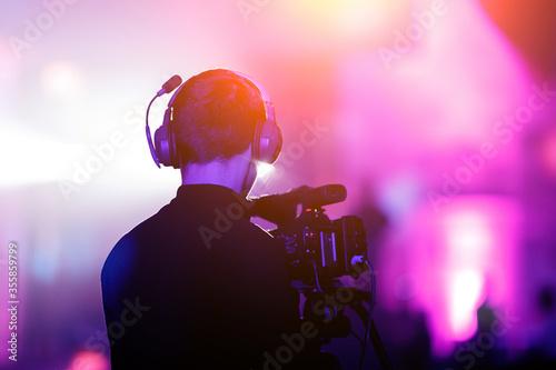 Cameraman at event. Purple background. Fotobehang