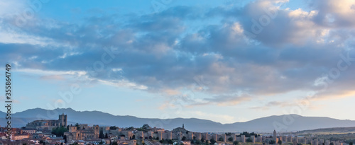Panoramic of the city of Ávila at sunset with the Sierra de La Paramera in the background