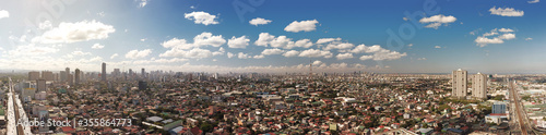 Quezon City, Philippines - March 2020: Panorama of Metro Manila cityscape and skyline viewed from EDSA Wallpaper Mural