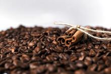 Cinnamon Sticks On Coffee Bean...