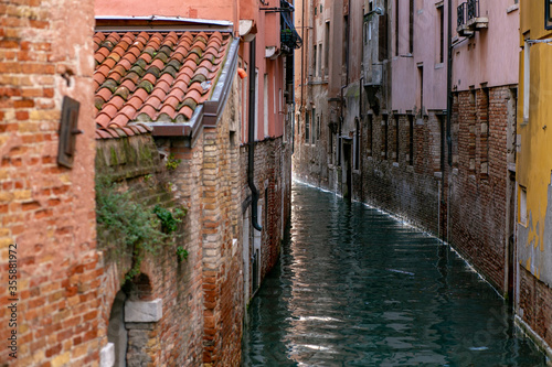 Fototapety, obrazy: horizontal photo of a narrow venetian canal flowing between old brick buildings