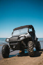 ATV On The Shore Of The Blue Sea On A Hot Summer Day