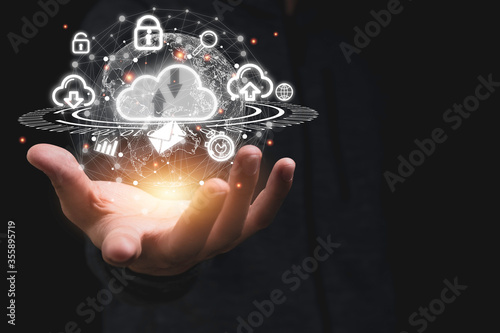 Fototapeta Hand holding virtual cloud computing with world and technology item such as upload download. Cloud technology management big data include business strategy , customer. obraz