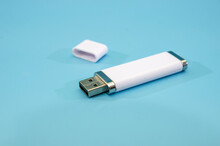 White Flash Drive Isolated On A Blue Background. Close-up.