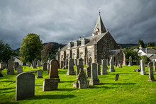 Old Church Of Moulin Graveyard Near Pitlochry, Scotland With Storm Clouds Over The Surrounding Hills.