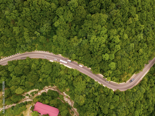 Fototapety, obrazy: Mountain winding zig zag road. Top aerial view: cars driving on road from above.