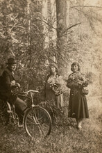 Germany - CIRCA 1930s: Man On Bicycle Talking With Two Woman In Forest. Vintage Archive Art Deco Era Photo