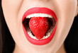 canvas print picture - Sexy young woman with strawberry in mouth, closeup