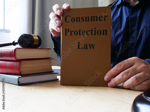 Photo Consumer Protection Law is shown on the conceptual business photo