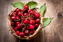 Ripe Cherries In A Wicker Basket