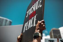 """""""Black Lives Matter"""" And """"No Justice No Peace"""" Protests Hand Sigh At Hawaii"""