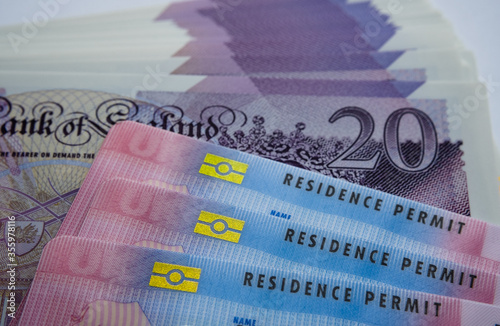 UK Biometric Residence permit cards and 20 pound banknotes Fototapeta