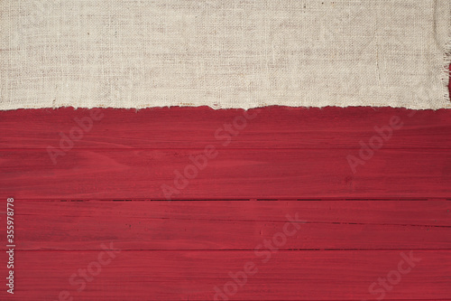 Rustic Red Wood Boards in Flat layout with off white Burlap fabric on top side as decorative design element.  It's horizontal but works as vertical and has copy space.