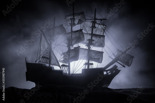 Fotomural Black silhouette of the pirate ship in night