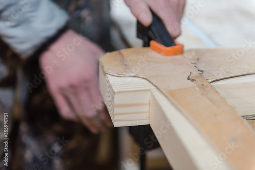 Fototapeta Fasten the boards with clamps