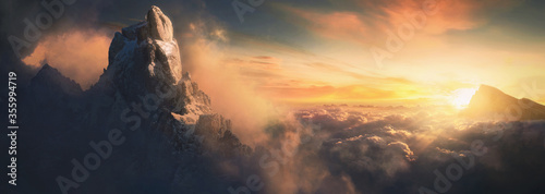 Beautiful aerial landscape of mountain peak at sunset above the clouds - panoram Billede på lærred