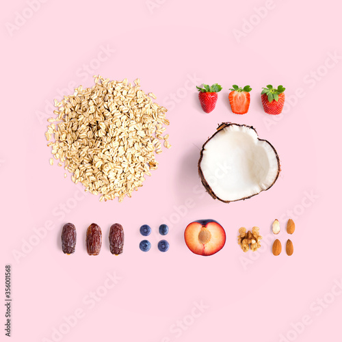 Cuadros en Lienzo Creative layout made of oatmeal, coconut, strawberry, plum, dried dates, blueberry, almond and walnut