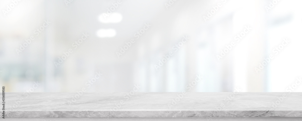 Fototapeta Empty white marble stone table top and blur glass window interior lobby and hall way banner mock up abstract background - can used for display or montage your products.