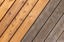 Close Up Abstract Texture Background Of A Cedar Wood Deck Floor With A Diagonal Layout Design, Showing New Boards Alongside Older Weathered Boards, With Copy Space