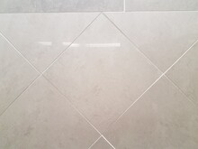 White Tile Wall In The Bathroom