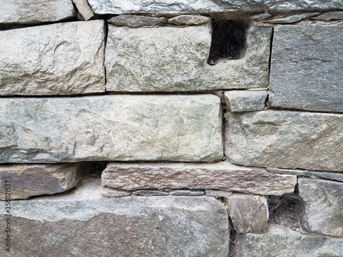 stone wall with holes in it