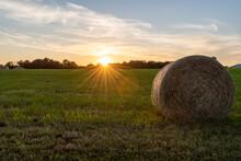 The Sun Sets Over A Farm Field...