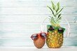 canvas print picture - Ripe pineapple and coconut with sunglasses and headphones