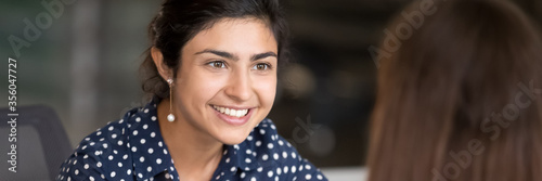 Indian girl having pleasant conversation during break at workplace Canvas-taulu