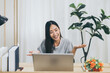 Beautiful young asian woman using video conference call to people
