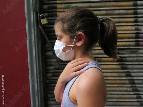 little girl with face mask Wallpaper Mural