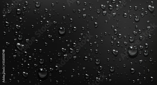 Condensation water drops on black glass background Fototapete