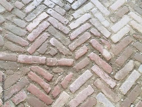 red bricks in a dirt floor