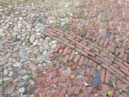 red brick and cobblestone or stone street