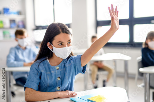 Girl with face mask back at school after covid-19 quarantine and lockdown Wallpaper Mural