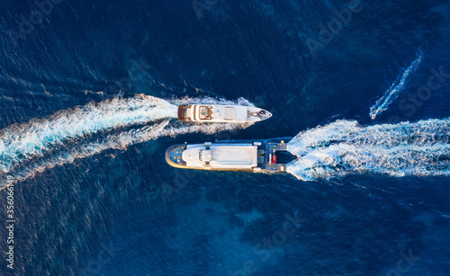 Obraz Aerial view of floating ship on blue Adriatic sea at sunny day. Fast ship on the sea surface. Seascape from the drone. Travel - image - fototapety do salonu