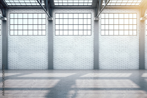 Fototapeta Modern warehouse interior with window and blank brick wall. obraz