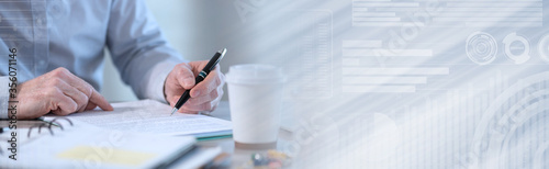 Businessman checking a document; panoramic banner Fototapete
